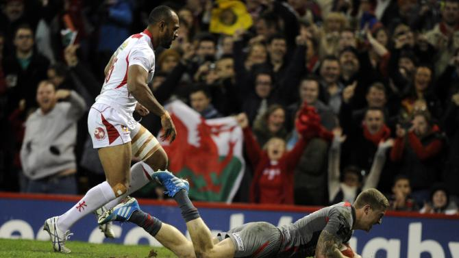 Tonga's Vunga Lilo (L) fails to stop Wales' Owen Williams from scoring a try during their international rugby union match at the Millennium Stadium in Cardiff