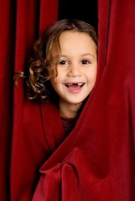 5 Ways to Promote Your Webinar image girl performer red curtains theatre iStock 000010970241Small