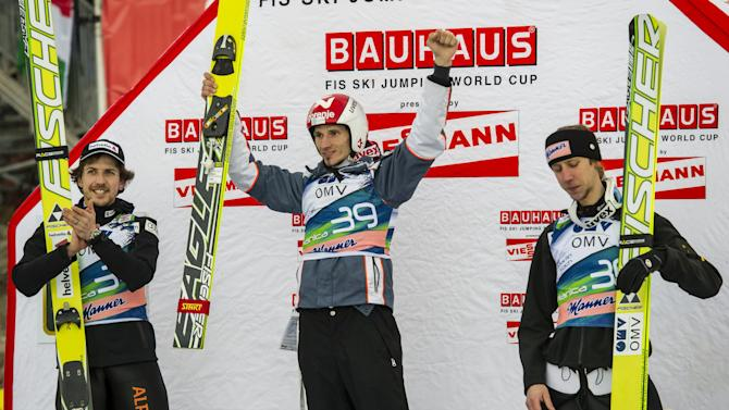 Winner Slovenia's Robert Kranjec (C), second-placed Switzerland's Simon Aman (L) and third-placed Austria's Martin Koch (R) celebrate during the flower ceremony at FIS Ski Flying World Cup in Planica on March 16, 2012.  AFP PHOTO / Jure Makovec (Photo credit should read Jure Makovec/AFP/Getty Images)