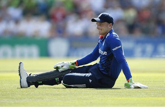 England's Jos Buttler reacts after a dropped catch