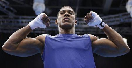 Britain's Anthony Joshua celebrates after he was declared the winner over Italy's Roberto Cammarelle following their Men's Super Heavy (+91kg) gold medal boxing match at the London Olympic