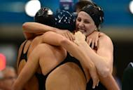 US swimmer Missy Franklin (R) hugs teammates after they won the women's 4x100m medley relay final during the swimming event at the London 2012 Olympic Games