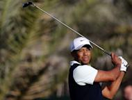 US golfer Tiger Woods plays a shot during the first round of the Abu Dhabi Golf Championship at the Abu Dhabi Golf Club in the Emirati capital on January 17, 2013. Justin Rose grabbed a share of the first round lead in the Abu Dhabi Golf Championship on a day when both Rory McIlroy and Woods struggled to get their seasons into gear