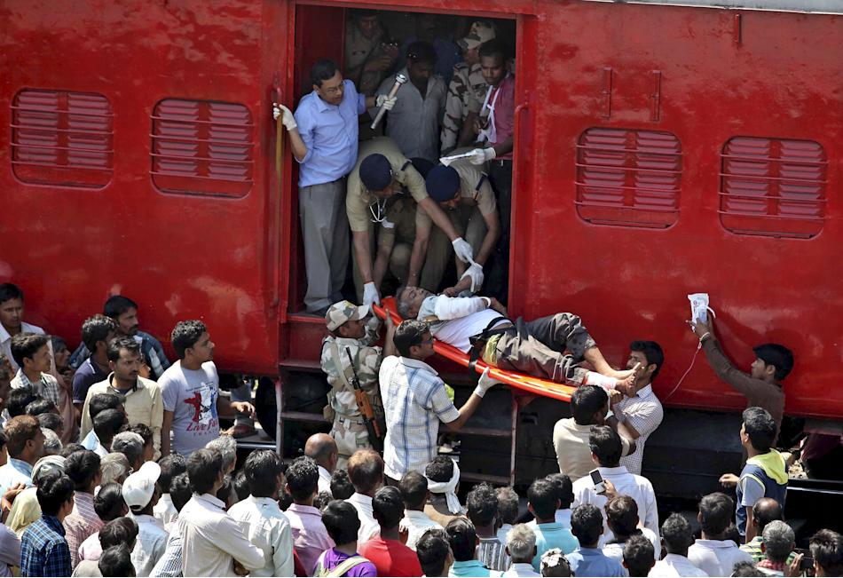 An injured passenger is being taken on a stretcher after a train accident at Rae Bareli district in Uttar Pradesh