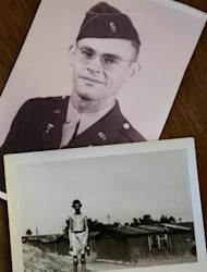 In this Tuesday, April 2, 2013 photo a World War II era photo of U.S. Army medic Donald Johnson, top, lies next to a 1945 photograph taken by Johnson that shows a boy in what is believed to be the Nazi Mauthausen concentration camp, at the home of filmmaker Matthew Nash, in Boston. Nash's discovery of photographs by Johnson, his grandfather, led him to create a documentary about the liberation of the Ohrdruf concentration camp in Germany, the first that the Americans found. (AP Photo/Steven Senne)