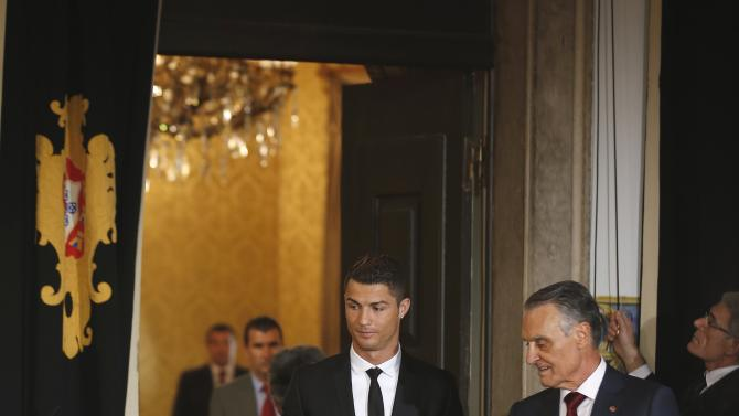 Portugal's soccer team captain Ronaldo arrives to be decorated with the Ordem do Infante Dom Henrique by Portugal's President Cavaco Silva in Lisbon