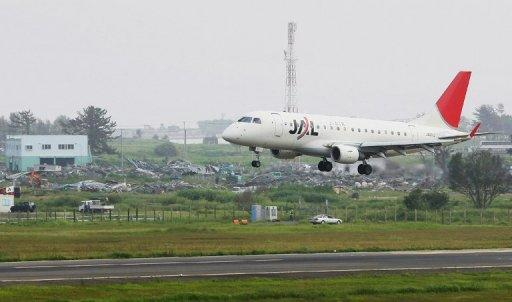 File photo shows a JAL passenger plane landing at Sendai airport in Natori, Miyagi prefecture. A huge unexploded World War II bomb has been found buried near the runway of one of Japan's busiest regional airports, forcing all flights to be cancelled Tuesday, officials said.
