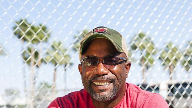 "FILE - In this April 28, 2013 file photo, singer Darius Rucker poses for a portrait backstage on day 3 of the 2013 Stagecoach Music Festival at the Empire Polo Club, in Indio, Calif. Rucker's version of ""Wagon Wheel"" is the most successful song of his country career. The cut from his third Nashville-recorded album, ""True Believers,"" out on May 21, 2013, has sold nearly 1.2 million copies and sat atop the country charts for three consecutive weeks early this year. (Photo by Dan Steinberg/Invision/AP, File)"