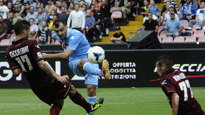 Napoli striker Goran Pandev, second from left, scores during a Serie A soccer match between Napoli and Livorno, at the Naples San Paolo stadium, Italy, Sunday, Oct. 6, 2013