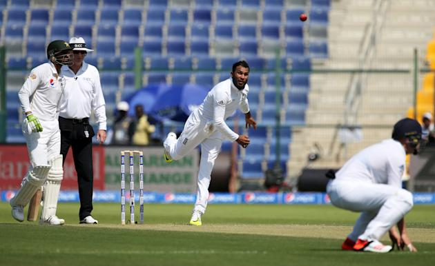 England's Adil Rashid (C) in action