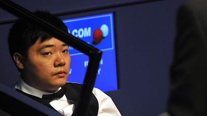 Ding Junhui of China looks on as he waits to play during his first round match of the World Championship Snooker tournament against Ryan Day of Wales at the Crucible Theatre in Sheffield, north-west England on April 24, 2012. AFP PHOTO / PAUL ELLIS (Photo credit should read PAUL ELLIS/AFP/Getty Images)