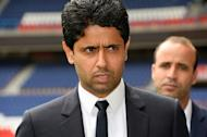 Nasser Al-Khelaifi (L) is prominent now as president of Paris Saint-Germain but owes his start in sport to his prowess at tennis