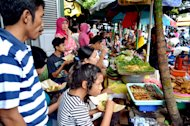 Eat it while its hot: Street food with a traditional menus can be easily found around the Traditional Market Beringharjo. (