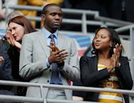 "Fabrice Muamba with his girlfriend Shauna Magunda before the FA Cup final between Liverpool and Chelsea at Wembley in May. Announcing his retirement, Patrice Muamba said on Wednesday: ""I thank God that I am alive and I pay tribute once again to the members of the medical team who never gave up on me."""