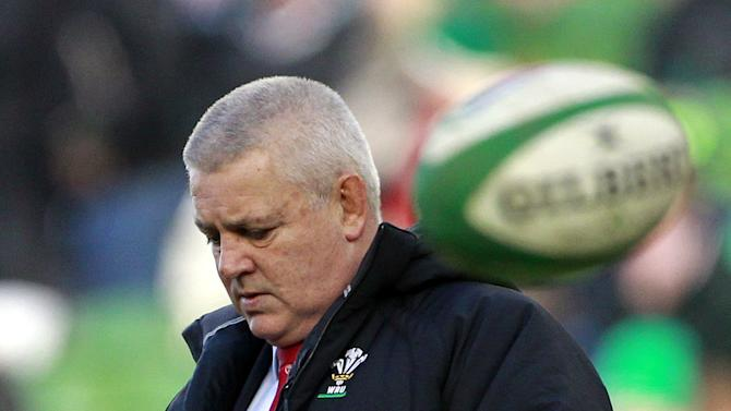 Wales manager Warren Gatland walks onto the pitch before his side play Ireland during their Six Nations Rugby Union international match at the Aviva Stadium, Dublin, Ireland, Saturday, Feb. 8, 2014. (AP Photo/Peter Morrison)