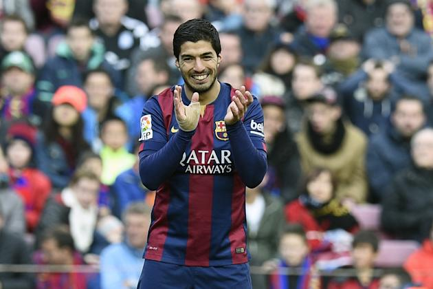 Barcelona's Uruguayan forward Luis Suarez claps during the Spanish league football match Barcelona vs Malaga at the Camp Nou stadium in Barcelona on February 21, 2015