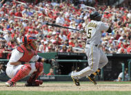 Josh Harrison, de los Piratas de Pittsburgh, en acción en el partido contra los Cardenales de San Luis, el domingo 19 de agosto de 2012. (Foto AP/St. Louis Post-Dispatch, Chris Lee)