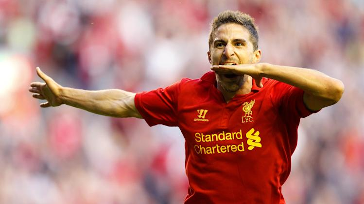 Liverpool's Fabio Borini celebrates scoring on his home debut