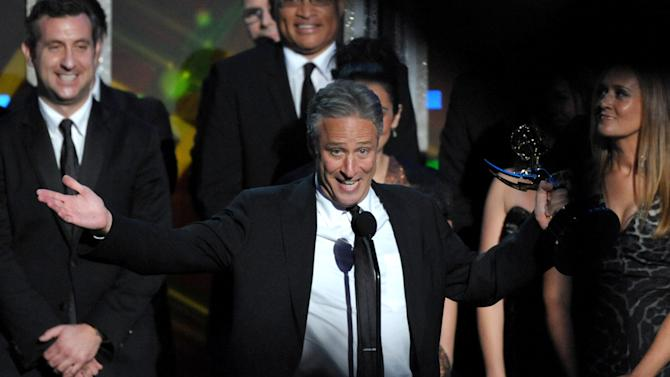 """Jon Stewart accepts the award for Outstanding Variety Series for """"The Daily Show with Jon Stewart"""" at the 64th Primetime Emmy Awards at the Nokia Theatre on Sunday, Sept. 23, 2012, in Los Angeles. (Photo by John Shearer/Invision/AP)"""