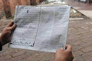 A Kashmiri Muslim reads a notice with instructions concerning a response to nuclear weapons issued by the police in Srinagar on January 22, 2013. Police in Indian Kashmir have warned residents to build underground bunkers to prepare for a possible nuclear war in the disputed region, which is on edge after a string of deadly border clashes