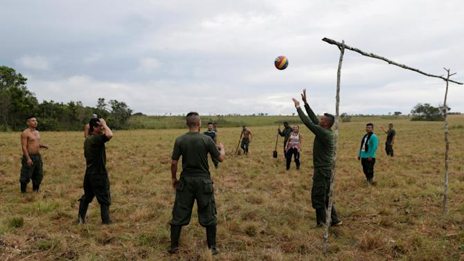Fighters from Revolutionary Armed Forces of Colombia (FARC) play volleyball at a camp where they prepare to ratify a peace deal with the government, near El Diamante in Yari Plains