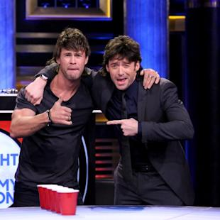 Chris Hemsworth and Hugh Jackman play Musical Beers on March 5, 2015 -- Getty Images