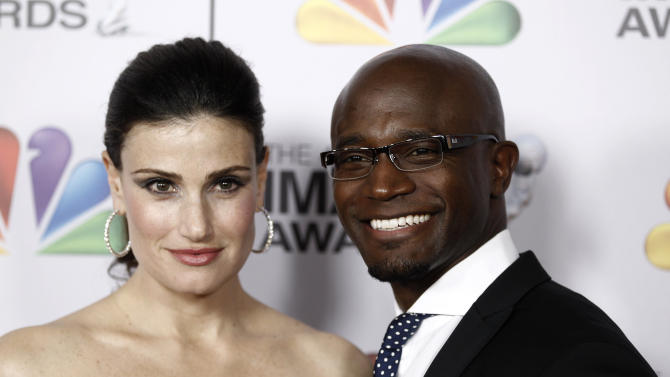 "FILE - In this Feb. 17, 2012 file photo, married actors Idina Menzel, left, and Taye Diggs arrive at the 43rd NAACP Image Awards in Los Angeles. Diggs and Menzel met while in ""Rent"" off-Broadway and married in 2003 after dating for seven years. The pair once again co-starred on Broadway in the show ""Wild Party"" in 2000 and on the TV show ""Private Practice."" (AP Photo/Matt Sayles, File)"