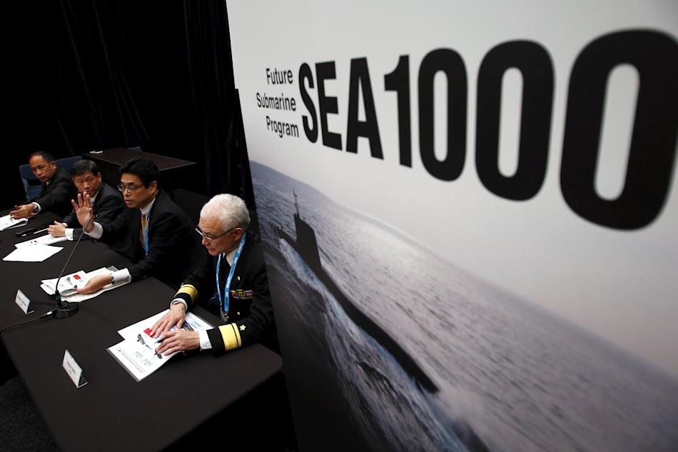Members of a Japanese government and Industry delegation answer questions during a media conference regarding the Future Submarine Program SEA1000 held at the 2015 Pacific International Maratime Expos