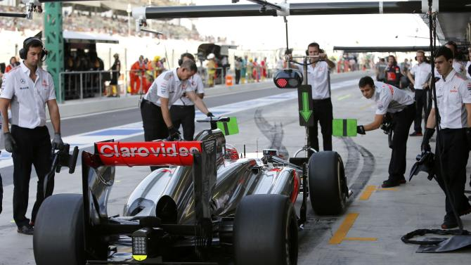 McLaren Formula One driver Button of Britain makes a pit stop during the third practice session of the Abu Dhabi F1 Grand Prix at the Yas Marina circuit on Yas Island