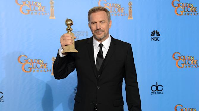 "Kevin Costner poses with the award for best performance by an actor in a mini-series or a motion picture made for television for ""Hatfields & McCoys"" backstage at the 70th Annual Golden Globe Awards at the Beverly Hilton Hotel on Sunday Jan. 13, 2013, in Beverly Hills, Calif. (Photo by Jordan Strauss/Invision/AP)"