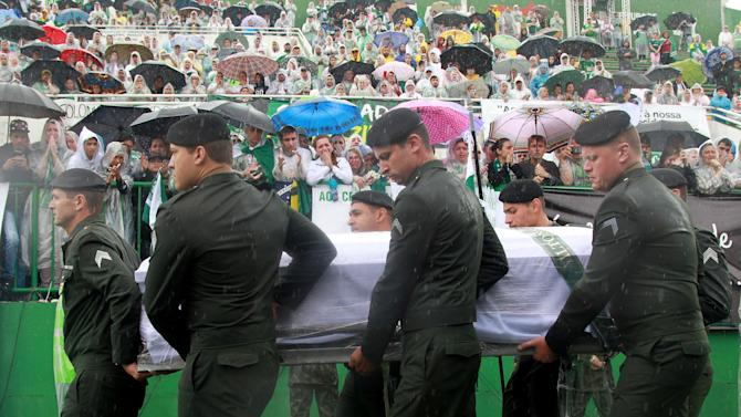 The coffin of one of the victims of the plane crash in Colombia arrives at the Arena Conda stadium in Chapeco
