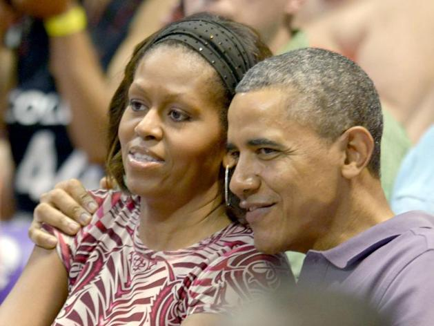 Barack et Michelle Obama assiste a un match de basket en decembre 2013 / Cory Lum/Picture Alliance/Rue des Archive
