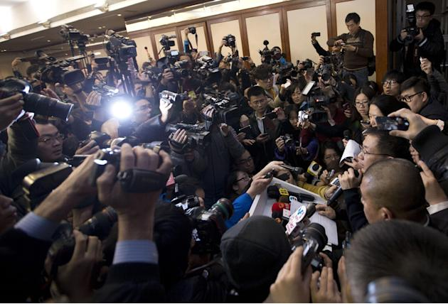 A spokesperson, right, from the Malaysia Airlines speaks to the media during a news conference at a hotel in Beijing Saturday, March 8, 2014. Search teams across Southeast Asia scrambled on Saturday t