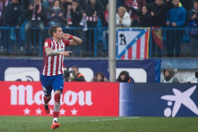 Atletico Madrid's midfielder Gabi celebrates after scoring during the Spanish league football match Club Atletico de Madrid vs SD Eibar at the Vicente Calderon stadium in Madrid on February 6, 201
