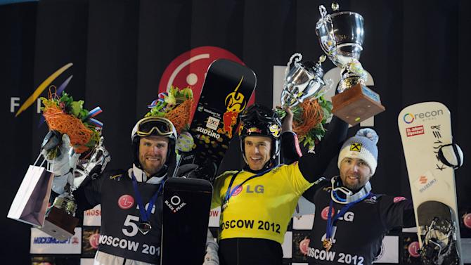 Winner Italy's Roland Fischnaller (C), second-placed Switzerland's Simon Schoch (L) and third-placed Austria's Andreas Prommegger celebrate on the podium of the men's parallel giant slalom event during the FIS World Snowboarding Cup in Moscow on March 3, 2012.  AFP PHOTO / ALEXANDER NEMENOV (Photo credit should read ALEXANDER NEMENOV/AFP/Getty Images)