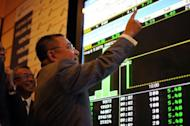 Chairman of Felda Global Ventures Holding Berhad Mohd Isa Abdul Samad points to a digital display showing share prices after the listing debut of Felda Global on the Malaysia Stock Exchange in Kuala Lumpur on June 28, 2012. Malaysia is tipped to be Asia's top IPO market for 2012 thanks to two of the world's biggest company listings this year, but analysts say the momentum is likely to fizzle out
