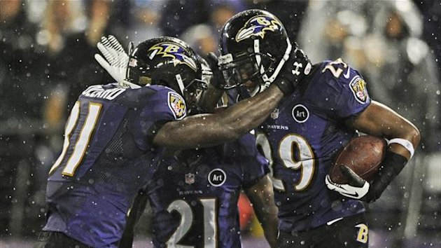 Baltimore Ravens cornerback Cary Williams (29), celebrates his interception touchdown with team mates Lardarius Webb (21) and Bernard Pollard (Reuters)