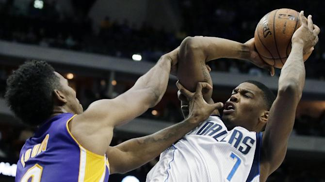 Los Angeles Lakers' Nick Young (0) fouls Dallas Mavericks' Ricky Ledo (7) on a shot attempt in the second half of an NBA basketball game, Tuesday, Nov. 5, 2013, in Dallas. The Mavericks won 123-104