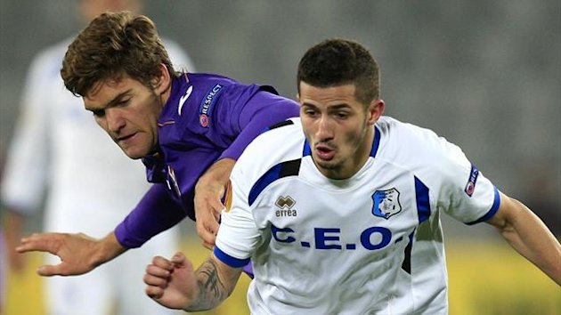 Fiorentina's Marcos Alonso (left) challenges Pandurii Targu-Jiu's Alin Buleica in the Europa League (Reuters)