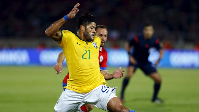 Hulk of Brazil fights for the ball with Diaz of Chile during their 2018 World Cup qualifying soccer match in Santiago