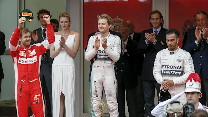 Mercedes Formula One drivers Rosberg of Germany and Hamilton of Britain celebrate on the podium with Ferrari Formula One driver Vettel of Germany after the Monaco Grand Prix in Monaco