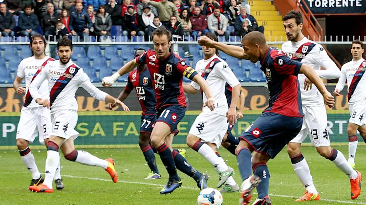 Genoa's Sebastien De Maio, right, scores during a Serie A soccer match between Genoa and Cagliari, at the Genoa Luigi Ferraris Stadium, Italy, Saturday, April 19, 2014