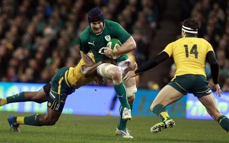 Ireland's O'Brien is challenged by Australia's Cooper and Kuridrani in their International rugby union match in Dublin