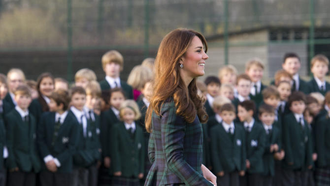 """Kate, the Duchess of Cambridge, plays hockey, during her visit to St. Andrew's School, where she  attended school from 1986 till 1995, in Pangbourne, England, Friday, Nov. 30, 2012. The Duchess of Cambridge has gone back to school. The royal, formerly known as Kate Middleton, played hockey and revealed her childhood nickname — Squeak — when she returned to her elementary school for a visit Friday. Kate told teachers and students at the private St. Andrew's School in southern England that her 10 years there were """"some of my happiest years."""" She said that she enjoyed it so much that she had told her mother she wanted to return as a teacher. (AP Photo/Arthur Edwards, Pool)"""
