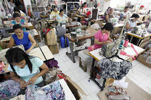 File photo of garment workers sewing maternity dresses at a factory of a Additional Pelf Joys Trading Corp. at Taytay city