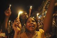 Myanmar demonstrators hold a candlelight protest at Sule pagoda against severe power cuts in Yangon. Protests against chronic power shortages in Myanmar spread to Yangon late Tuesday following rallies in the second city of Mandalay that saw several opposition party members briefly held by police