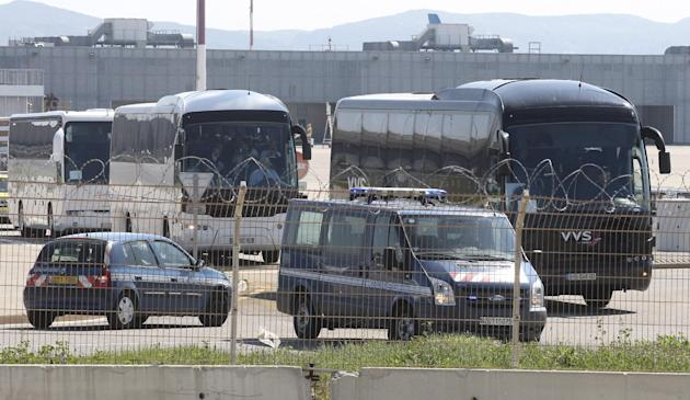 Relatives of victims travel in buses after their arrival at Marseille airport, southern France, Thursday March 26, 2015. The Germanwings Airbus A320, on a flight from Barcelona, Spain, to Duesseldorf,