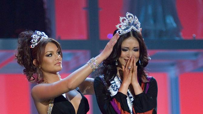 Riyo Mori, Miss Japan 2007, reacts as Zuleyka Rivera, Miss Universe 2006, crowns her Miss Universe 2007 at the 56th annual Miss Universe competition.