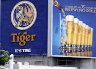 A huge billboard advertising Tiger Beer, brewed by Asia Pacific Breweries (APB), in Singapore. A nascent bidding war for the brewer of Tiger Beer between Dutch giant Heineken and Thai rivals underscores the growing importance of Southeast Asia's consumer market to global firms, analysts said Wednesday
