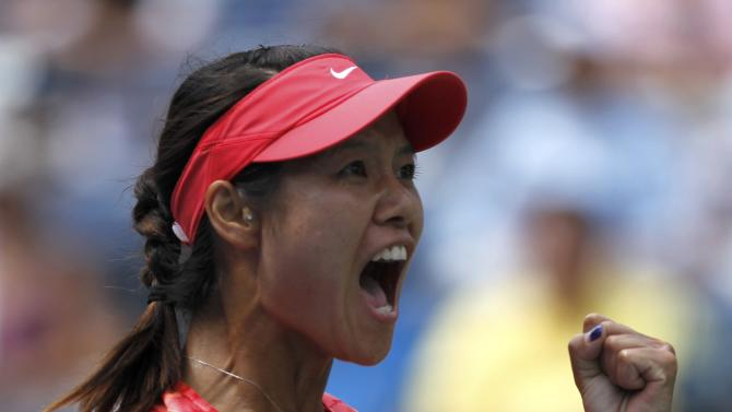 Li Na of China celebrate her victory over Robson of Britain at the U.S. Open tennis championships in New York